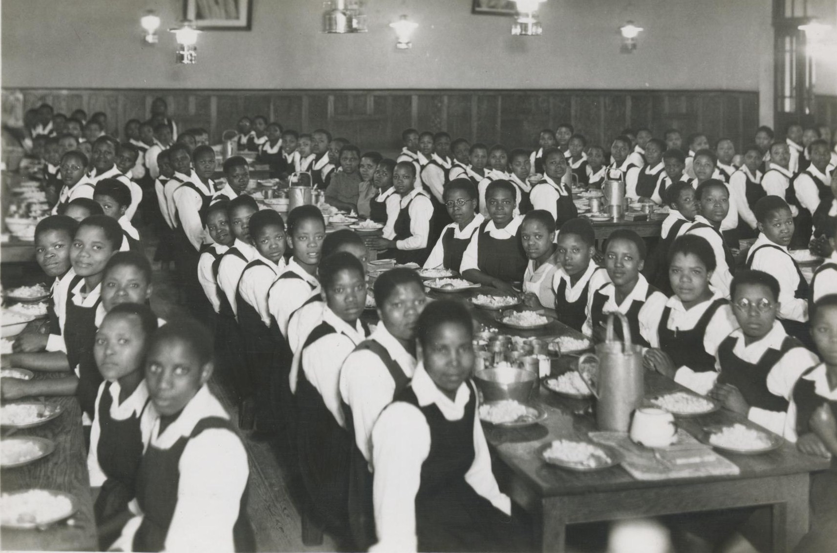 """Meal Time in the Girls' Hostel,"" South Africa (Image source: http://murraymcgregor.wordpress.com/chapter-15-the-chaos-of-%E2%80%9Cbantu%E2%80%9D-education/)"